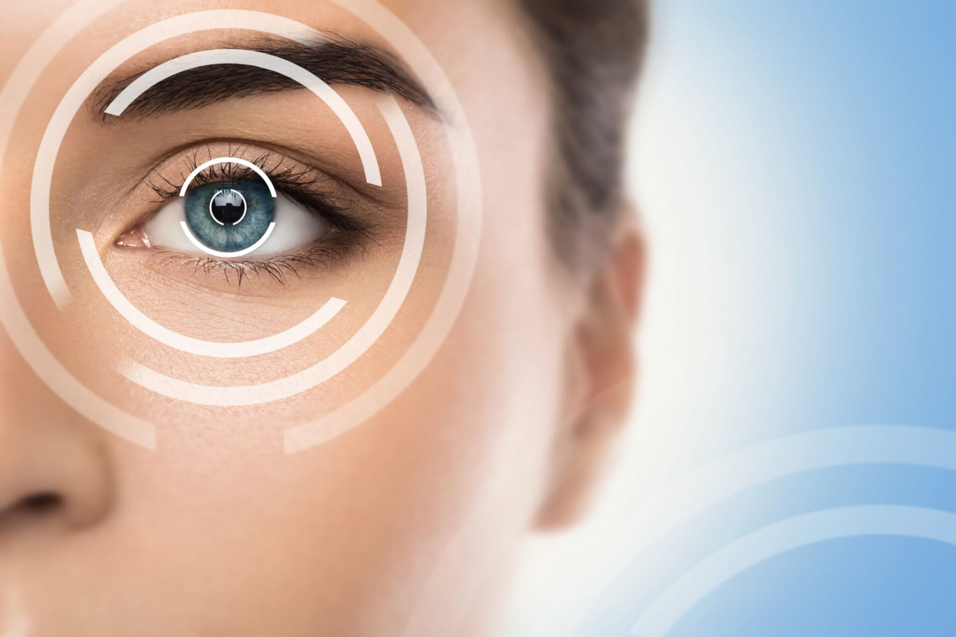 Close-up of female eye. Concepts of laser eye surgery or visual acuity check-up