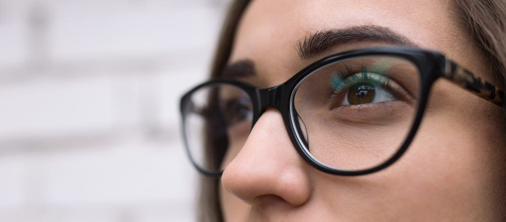 woman with brown eyes wearing glasses