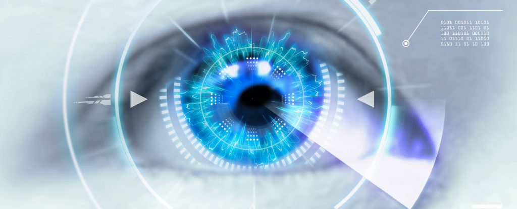 close up of eye with technology graphics