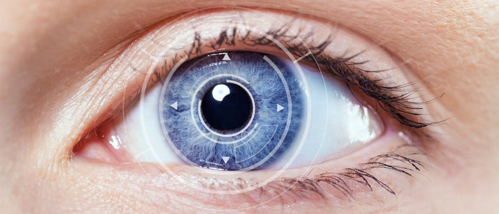 closeup of person's blue eye with computer graphic