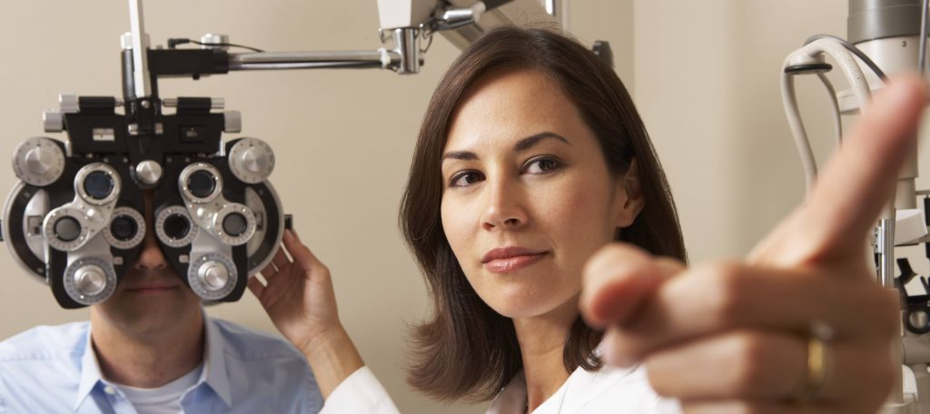 eye doctor performing checkup on patient