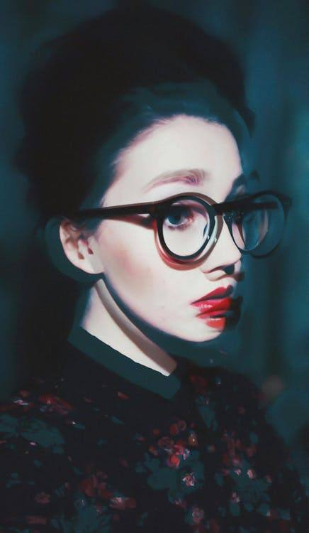 artistic graphic of young woman wearing glasses