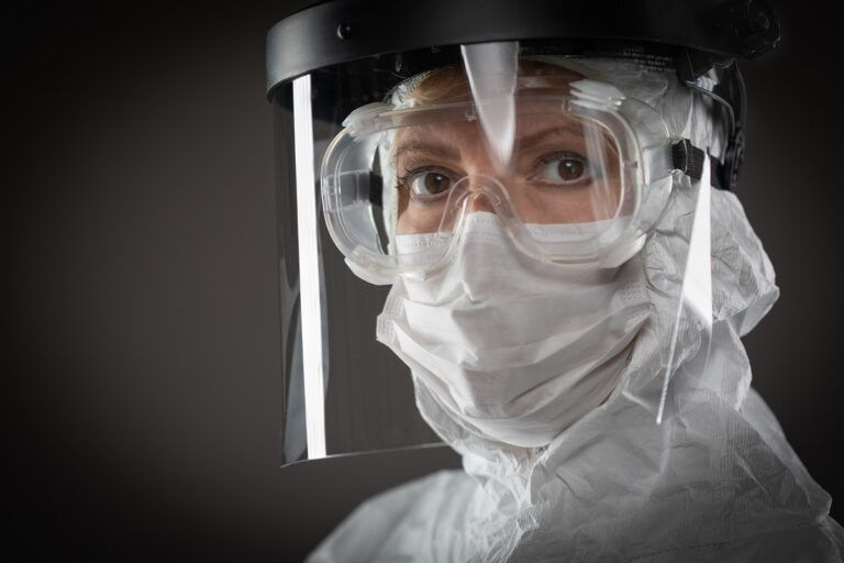 female medical worker wearing protective face mask and gear