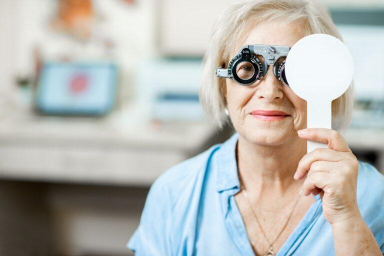 senior woman checking vision with eye test glasses