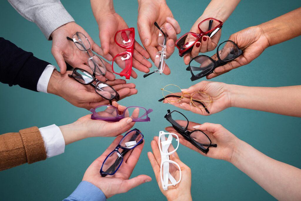 top view of peoples hand showing variety of spectacles
