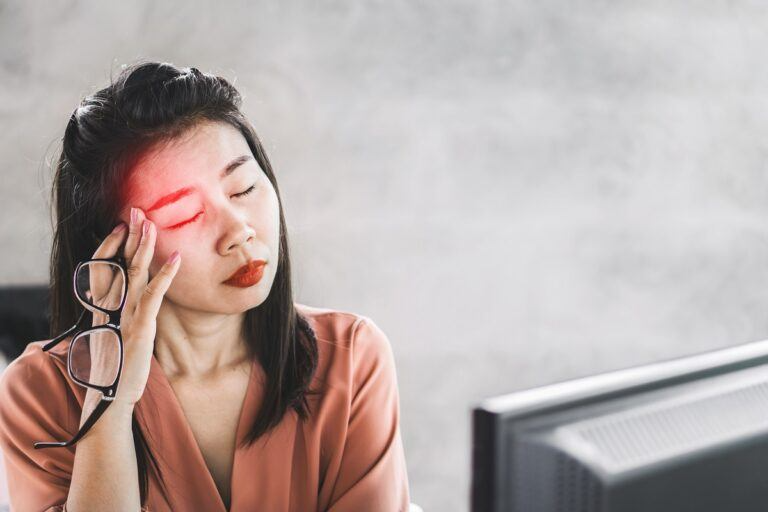 Woman suffering from eye pains