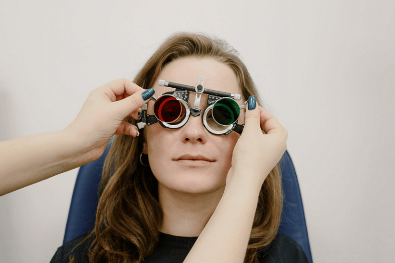 oculist choosing lenses for patient