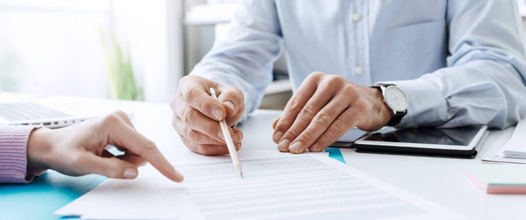 Man going over a form on a desk